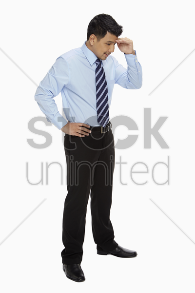 businessman smiling and looking below stock photo