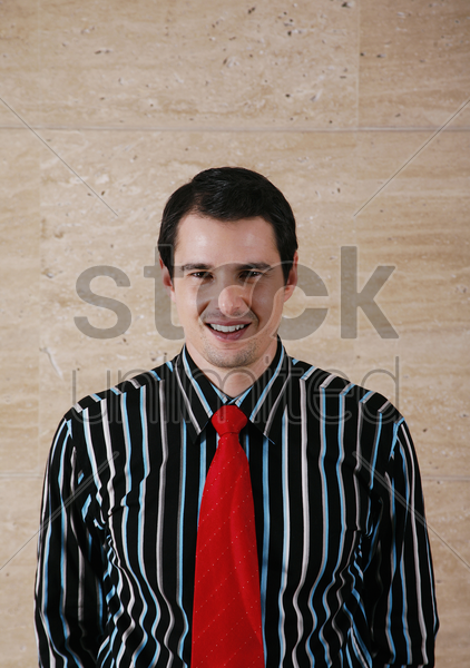 businessman smiling at the camera stock photo