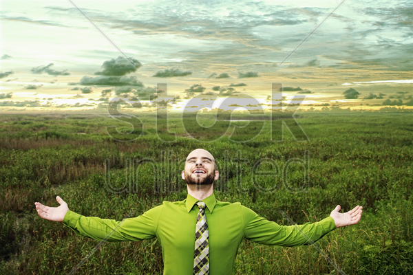 businessman standing with his arms outstretched stock photo