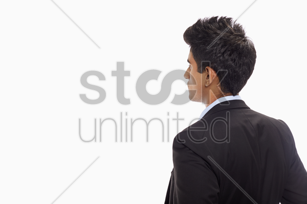 businessman standing with side facing the camera stock photo