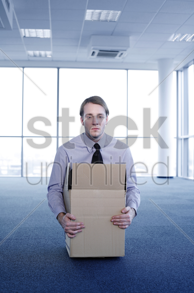 businessman staying in a box stock photo
