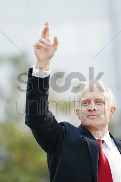 businessman stopping a taxi stock photo