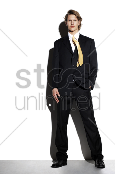 businessman striking a pose for the camera stock photo