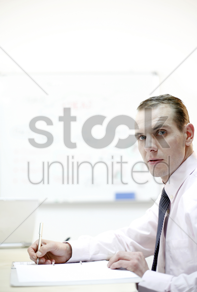 businessman taking down some important notes stock photo