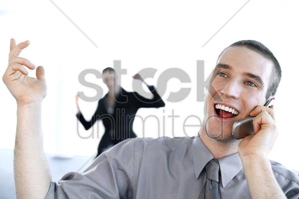 businessman talking happily on the mobile phone stock photo