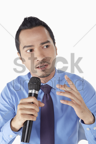 businessman talking into the microphone stock photo