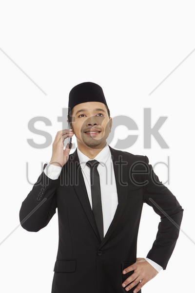 businessman talking on his mobile phone stock photo