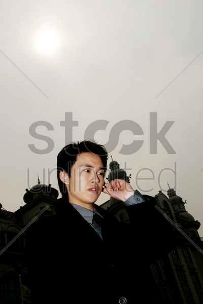 businessman talking on the bluetooth stock photo