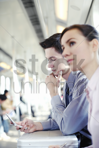 businessman text messaging in the train stock photo