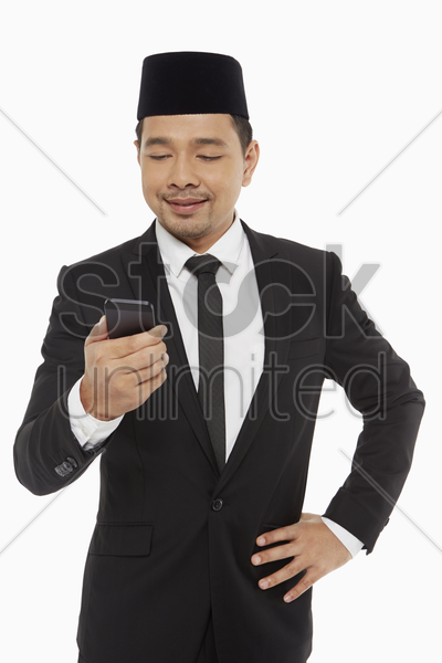 businessman text messaging on his mobile phone stock photo