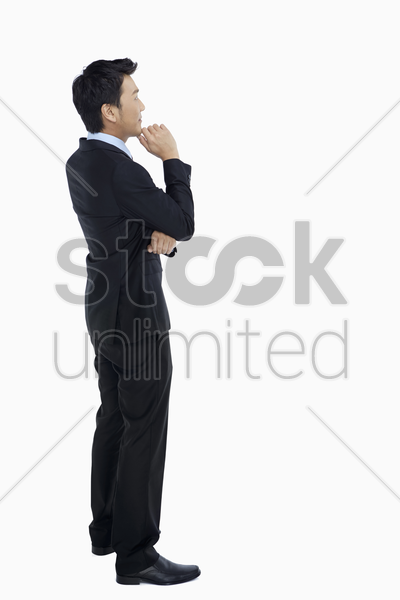 businessman thinking and contemplating stock photo
