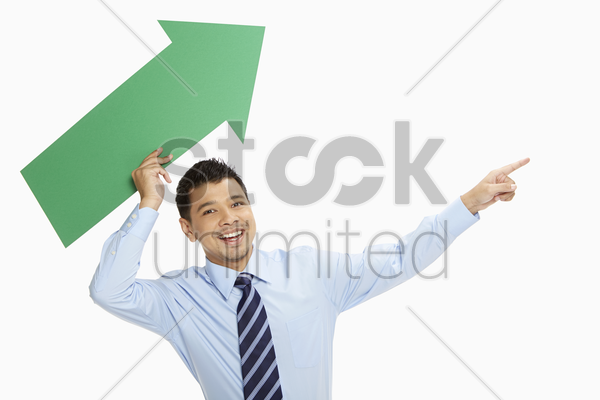businessman throwing an arrow upwards stock photo
