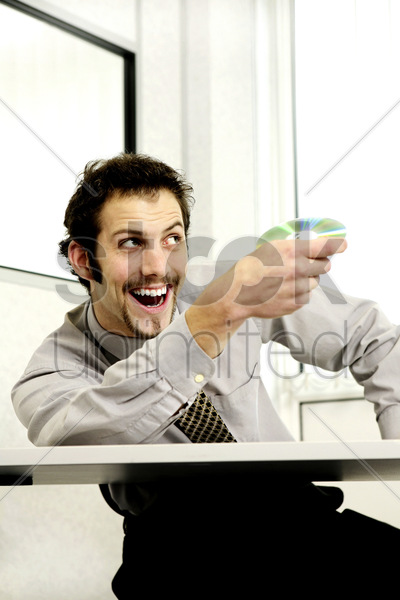 businessman throwing cd stock photo