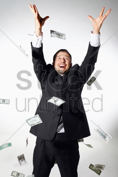 businessman throwing money in the air stock photo
