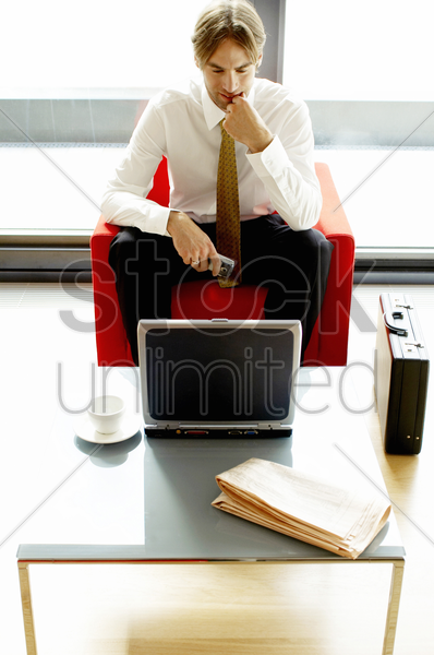 businessman using a laptop stock photo