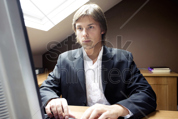 businessman using computer at home stock photo