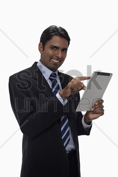 businessman using digital tablet stock photo