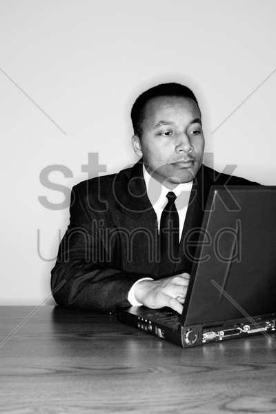 businessman using laptop stock photo