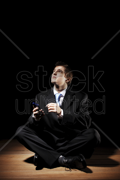 businessman using palmtop stock photo