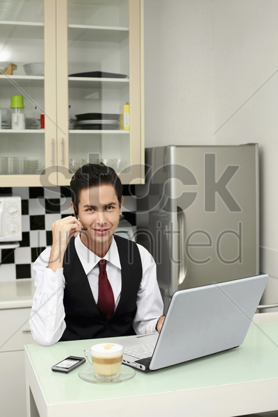 businessman video conferencing on laptop stock photo