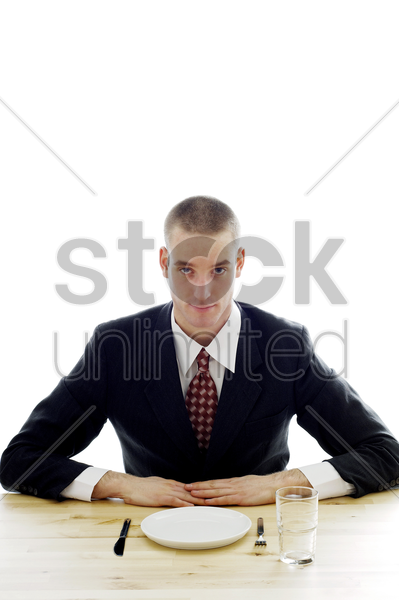 businessman waiting for his meal stock photo