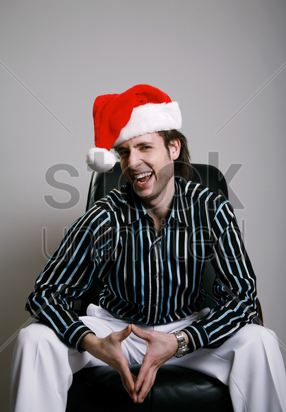 businessman wearing a christmas hat stock photo