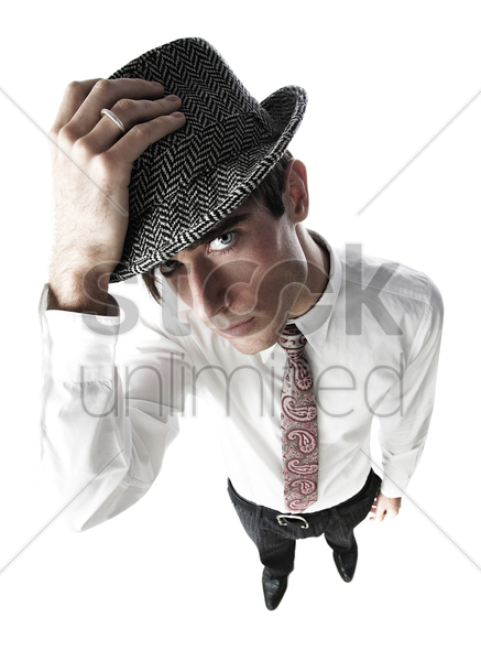 businessman wearing hat stock photo