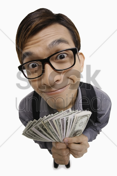 businessman with a big smile holding money stock photo