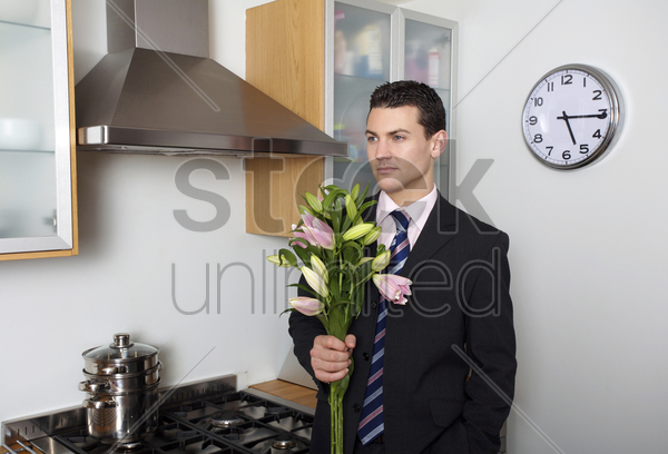 businessman with a bouquet of flowers stock photo