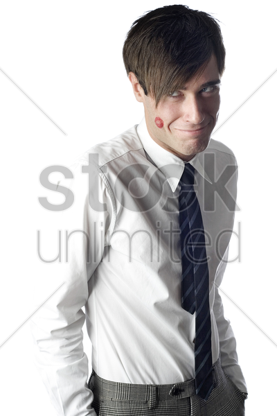 businessman with a lipstick stain on his cheek stock photo