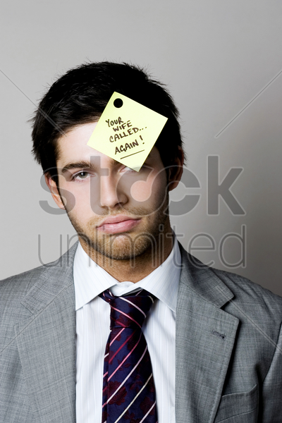 businessman with a phone message sticking on his forehead stock photo