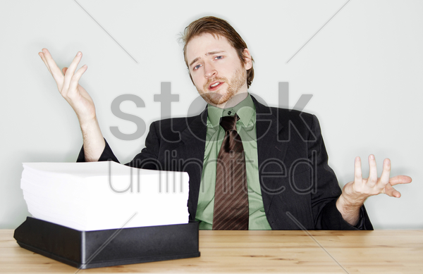 businessman with a pile of paper works stock photo