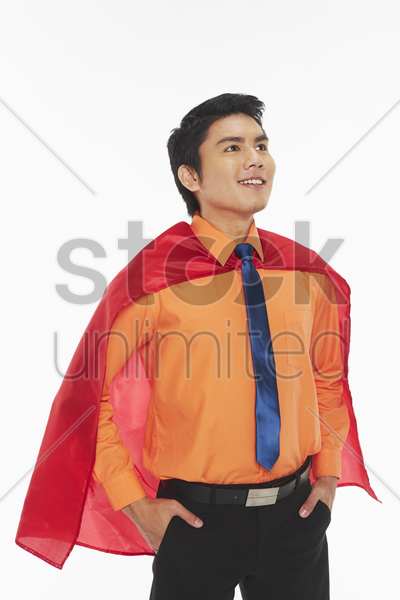 businessman with a red cape stock photo