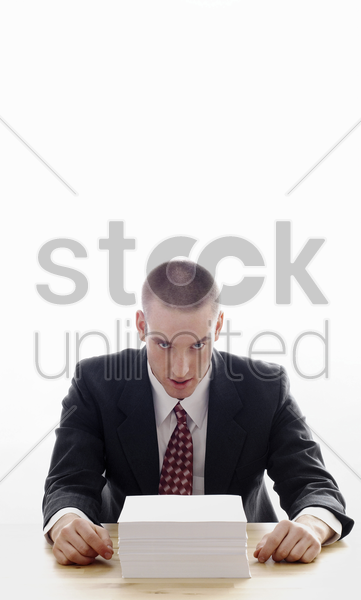businessman with a stack of papers on the table stock photo