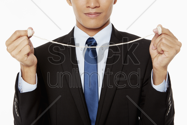 businessman with a string tied to his fingers stock photo