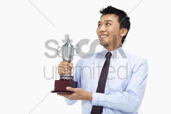 businessman with a trophy stock photo