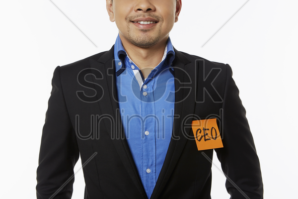 businessman with an adhesive note stuck on his jacket stock photo