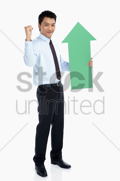 businessman with an arrow, cheering stock photo
