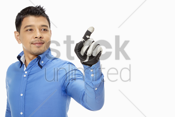 businessman with glove showing hand gesture stock photo