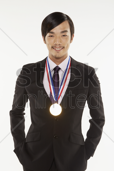 businessman with gold medal around his neck stock photo