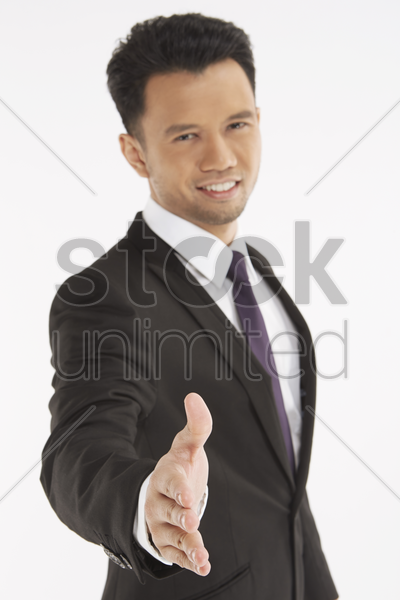 businessman with hand held out stock photo