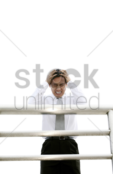 businessman with hands on head stock photo