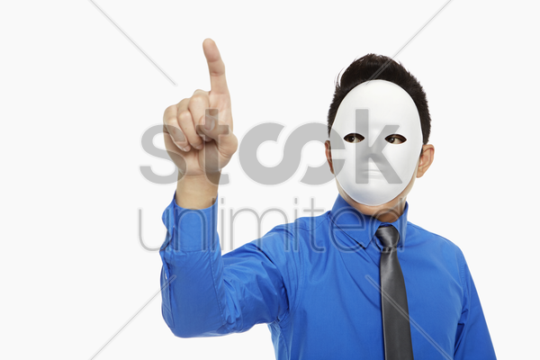 businessman with mask showing hand gesture stock photo