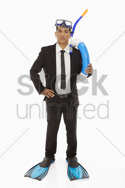 businessman with swimming gear looking at the camera stock photo