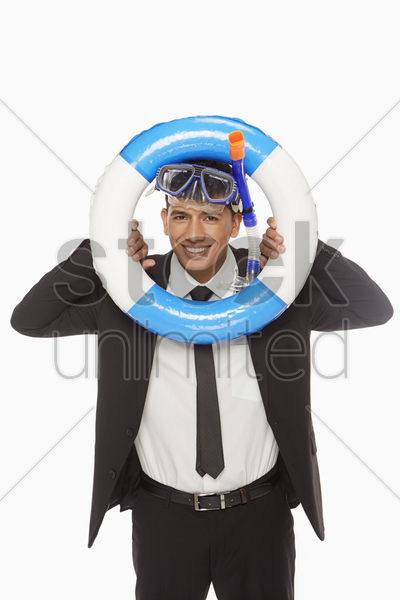 businessman with swimming gear looking through a swimming tube stock photo