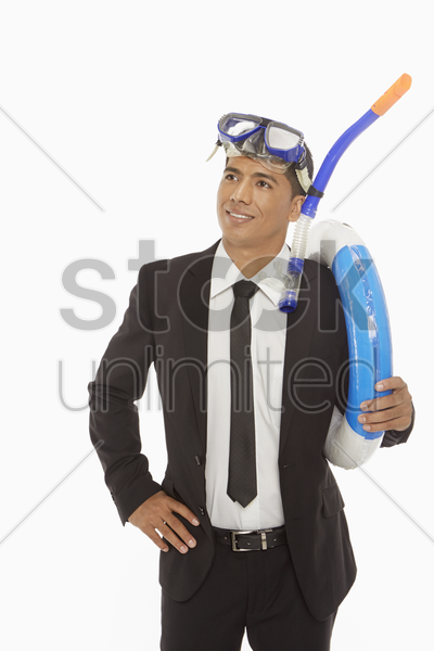 businessman with swimming gear smiling stock photo