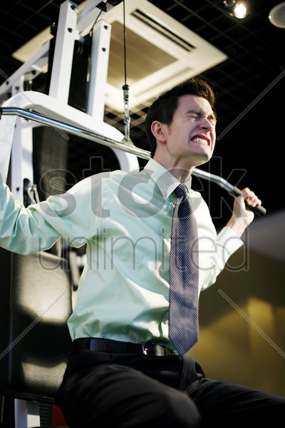 businessman working out in the gym stock photo