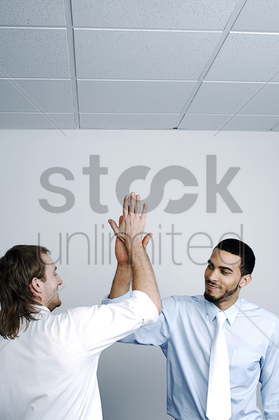 businessmen celebrating their success stock photo