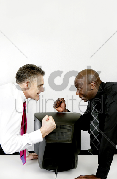 businessmen challenging each other stock photo