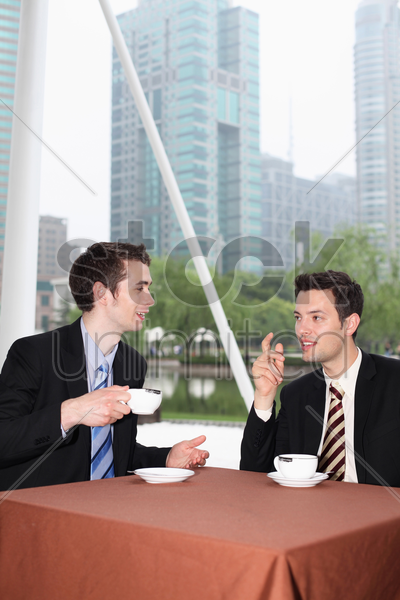 businessmen enjoying coffee at outdoor cafe stock photo